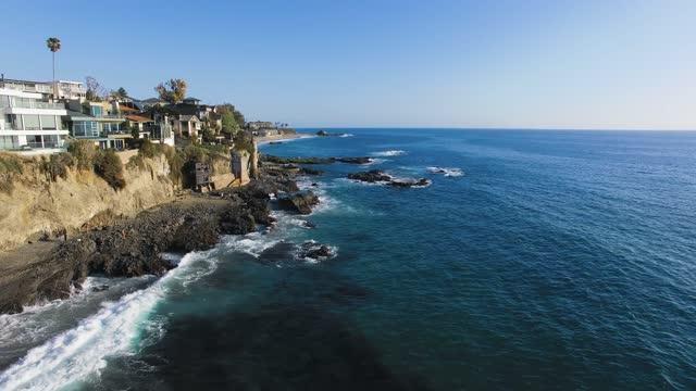 aerial shot of the steep american coast at laguna beach, california, usa, drone footage of pacific coast - laguna beach california stock videos & royalty-free footage