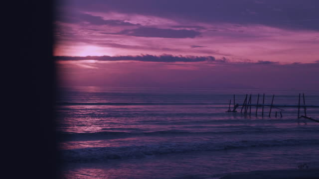aerial shot of the sun setting over the ocean horizon. - koh chang stock videos and b-roll footage