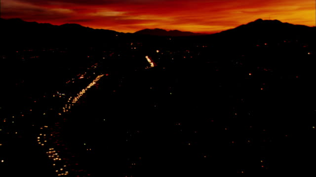 Aerial shot of the sun setting over the San Fernando Valley.