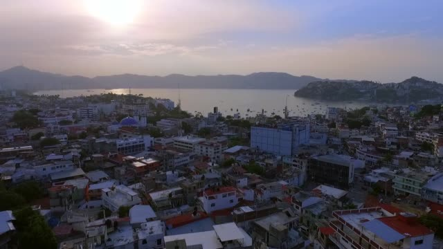 Aerial shot of the sunset in Acapulco Mexico