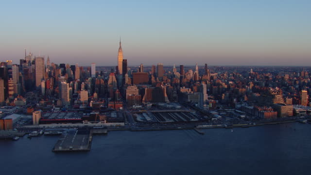 aerial shot of the waterfront in west side manhattan at golden hour. - golden hour stock videos & royalty-free footage