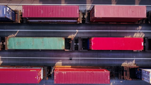 aerial shot of three freight trains - shipping stock videos & royalty-free footage