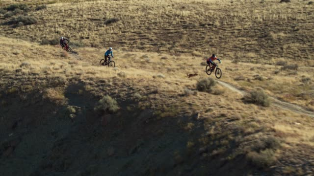 Aerial Shot of Three Mountain Bikers Riding Along a Ridge on 18 Road in Fruita, Colorado