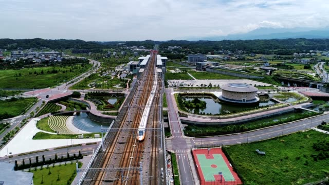 aerial shot of thsr miaoli station is a station of the taiwan high speed rail located in houlong township, miaoli county, taiwan. - rail transportation stock videos & royalty-free footage
