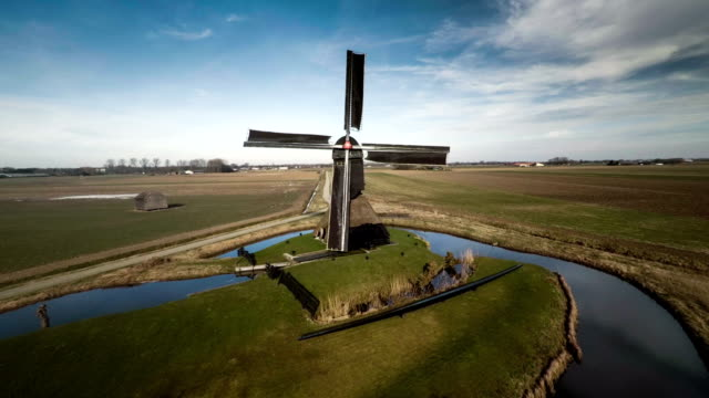 aerial shot of traditional windmill in the netherlands - mill stock videos & royalty-free footage
