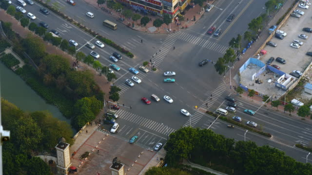 aerial shot of traffic intersection in guangzhou, china. shot from canton tower. - spoonfilm stock-videos und b-roll-filmmaterial