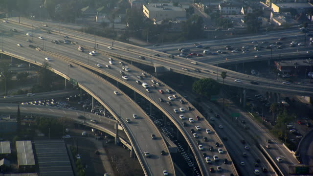 aerial shot of traffic on los angeles exit ramp for interstate 10, also known as the santa monica freeway. - interstate 10 stock videos & royalty-free footage