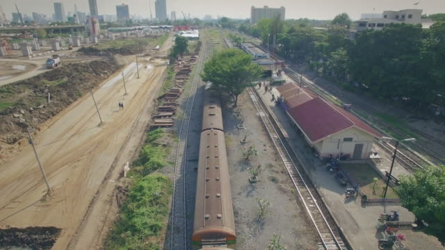 aerial shot of train arriving to the station - shunting yard stock videos and b-roll footage