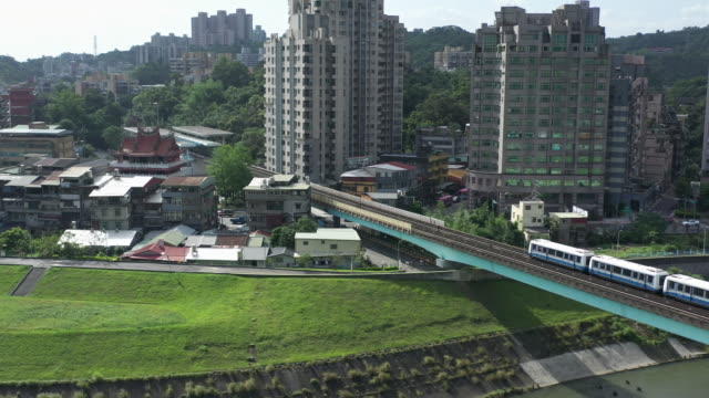 aerial shot of train entering station in the wenshan district of taipei, taiwan - rail transportation stock videos & royalty-free footage