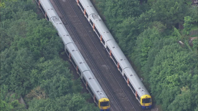 Aerial shot of trains passing each other on tracks