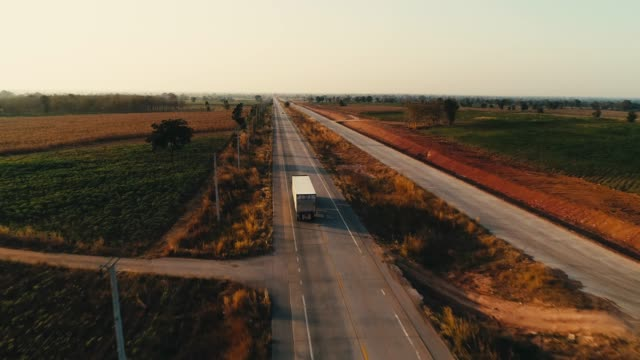 aerial shot of trucks driving - on the move stock videos & royalty-free footage