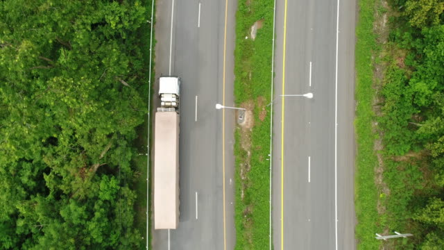 aerial shot of trucks driving - articulated lorry stock videos & royalty-free footage