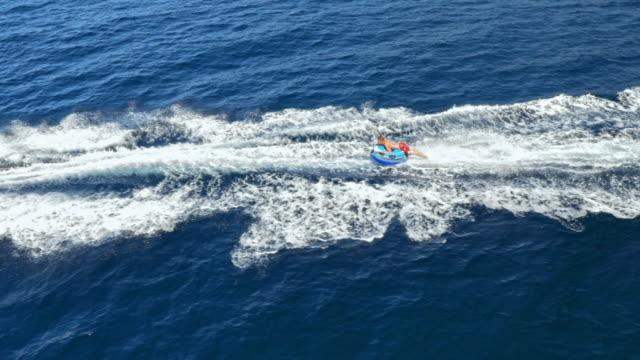 aerial shot of tubing on the sea - pantaloncino da bagno video stock e b–roll