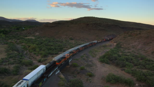 Aerial Shot of Two Freight Trains Passing Each Other