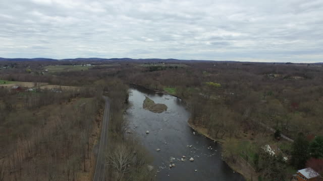 Aerial shot of upstate New York landscape, with river in center of frame