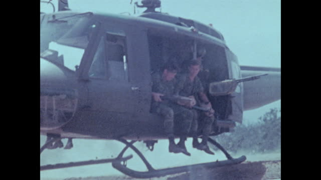 aerial shot of valley and then hueys landing and soldiers from the 101st airborne jump out arriving to assault a mountaintop overlooking the a shau... - vietnam stock videos & royalty-free footage