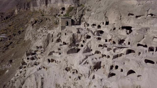 aerial shot of vardzia cave monastery site in georgia at the erusheti mountain - old ruin stock videos & royalty-free footage