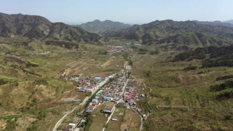 aerial shot of village in great wall of china mutianyu area - mutianyu stock videos & royalty-free footage