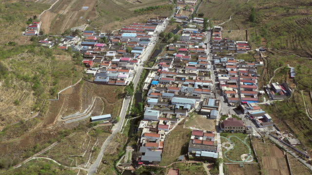 aerial shot of village in great wall of china mutianyu area - mutianyu stock videos and b-roll footage