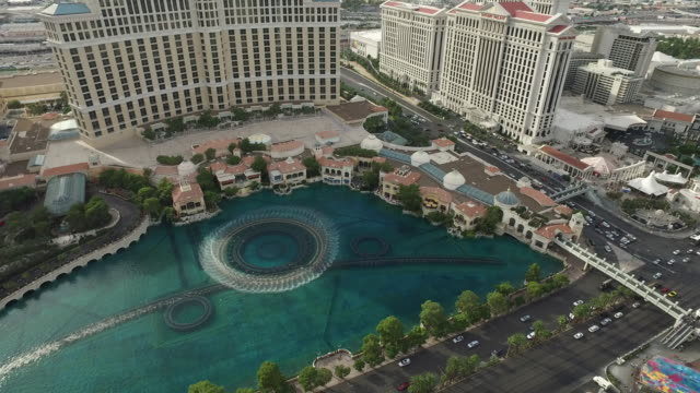 aerial shot of water fountain in las vegas - bally's las vegas stock videos & royalty-free footage
