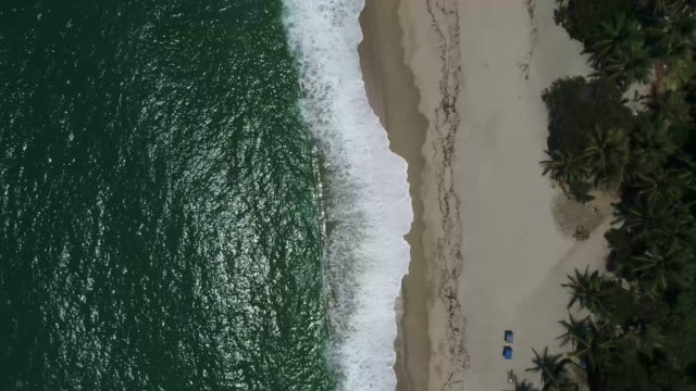 aerial shot of waves and beach, tayrona national park, colombia - tayrona national park stock videos and b-roll footage