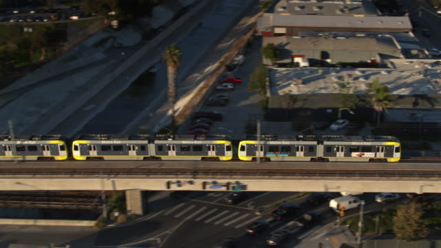 aerial shot of westbound expo line train in midcity los angeles - public transport stock videos & royalty-free footage