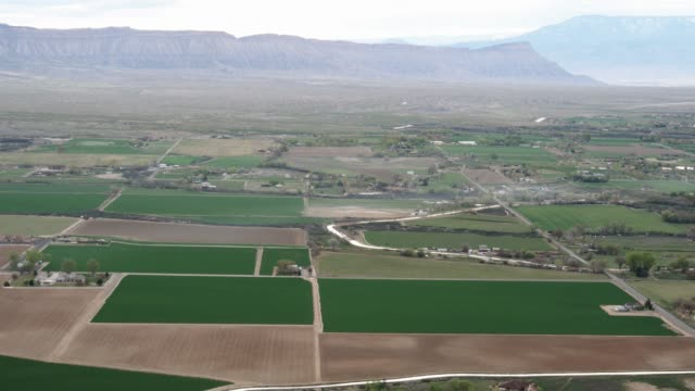 aerial shot of western colorado agriculture - irrigation equipment stock videos & royalty-free footage