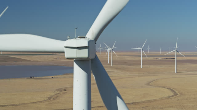 aerial shot of wind turbines in texas wind farm - mill stock videos & royalty-free footage