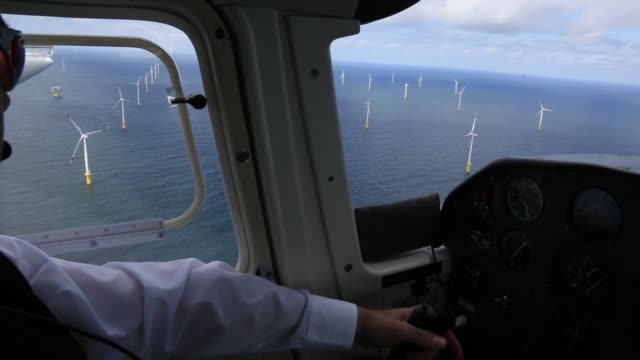 aerial shot of wind turbines operating on onshore farm land sites near hamburg, germany, on tuesday, june 16, 2015 shots: wind turbines stand in the... - helgoland stock videos & royalty-free footage