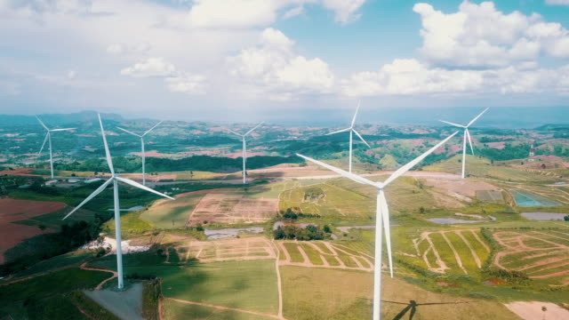 aerial shot of wind turbines - windmill stock videos & royalty-free footage
