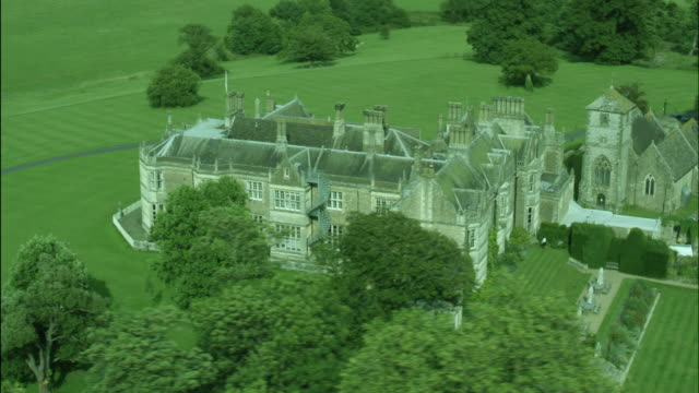 aerial shot of wiston house and st mary's church, west sussex, england - west sussex stock videos & royalty-free footage