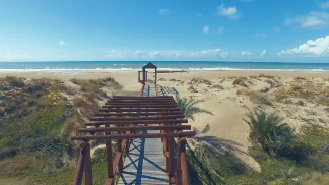 aerial shot of wooden walkway and bridge in the beach - cádiz stock videos and b-roll footage