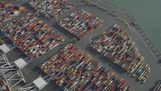 aerial shot of working container terminal - docks stock videos & royalty-free footage