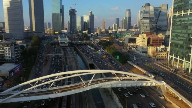 aerial shot of yehudit bridge over highway in city at sunset, drone flying forward over famous landmark - tel aviv, israel - israel stock videos & royalty-free footage