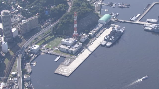 Aerial shot of Yokosuka Naval Base of the Japan Maritime SelfDefense Force Itsumi pier and townscape of Yokosuka