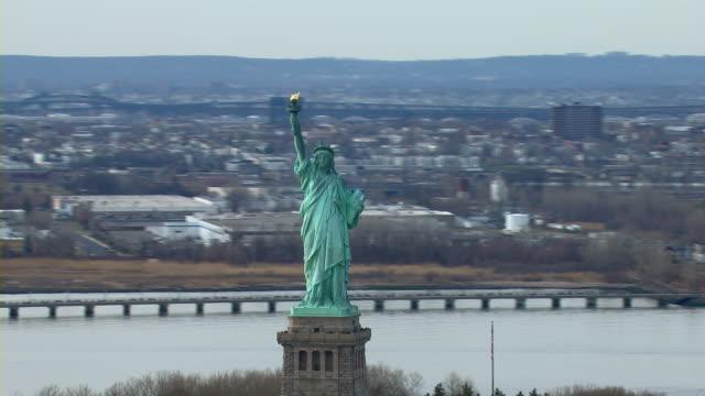 Aerial shot, orbiting around the Statue of Liberty in New York Harbor, New York, USA.