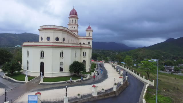 aerial shot, our lady of el cobre church and sierra maestra in cuba - cuba stock videos and b-roll footage