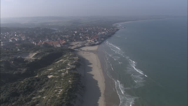 aerial shot over a beach on the cote d'opale coastline in northern france. .  - kustlinje bildbanksvideor och videomaterial från bakom kulisserna