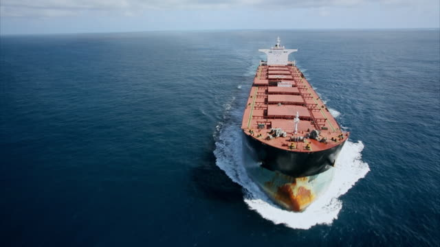 Aerial shot over a huge transport tanker ship.