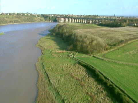 Aerial shot over a railway bridge. PAL, NTSC