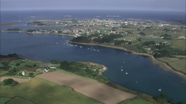 vídeos y material grabado en eventos de stock de aerial shot over a section of coastline in brittany.  - paisaje mosaico