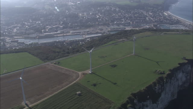 Aerial shot over a wind farm to the port of Fecamp in Upper Normandy.