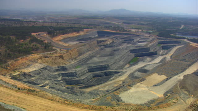 aerial shot over an open mine in the hunter valley, new south wales. - mine stock videos & royalty-free footage