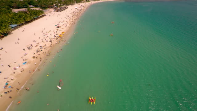 aerial shot over crowded beach in sanya, hainan province, china. - spoonfilm stock-videos und b-roll-filmmaterial