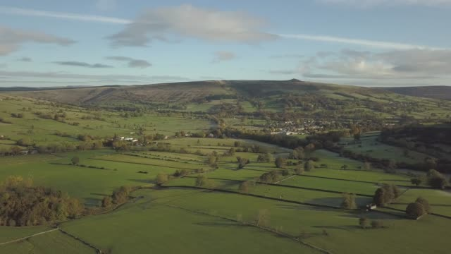 aerial shot over fields from hope to castleton in autumn, hope valley, peak district national park, derbyshire, england, united kingdom, europe - hill stock videos & royalty-free footage
