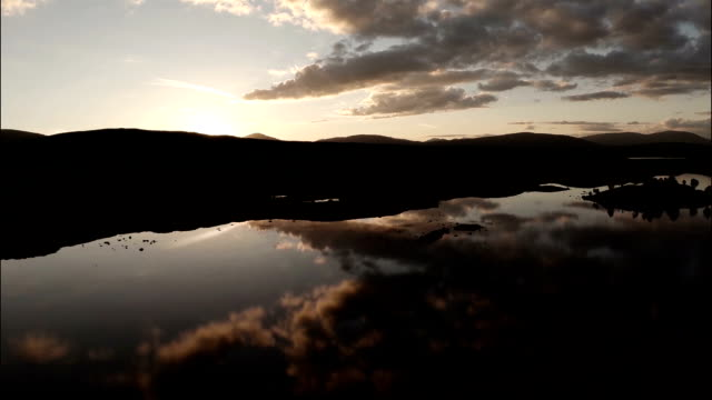 aerial shot over rannoch moor in scotland revealing a desolate and baron landscape during sunset 1 - twilight stock videos & royalty-free footage