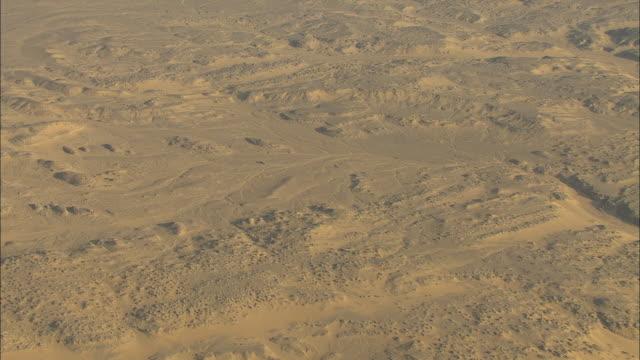 Aerial shot over sandy desert landscape in Egypt