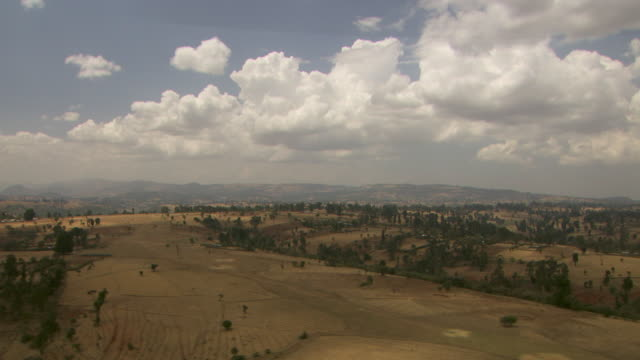 aerial shot over the hills of the ethiopian countryside. - ethiopia stock videos and b-roll footage