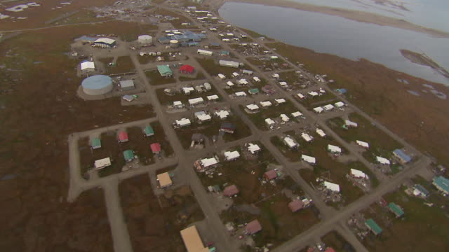 aerial shot over the inupiat city of kaktovik in alaska. - inuit stock videos and b-roll footage