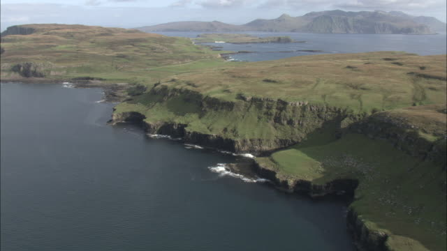 aerial shot over the isle of canna in the scottish inner hebrides.  - island stock videos & royalty-free footage